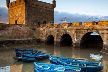 Boats beneath the fortified ramparts of Essaouira, Morocco